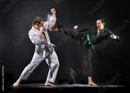 Karate fighters practices