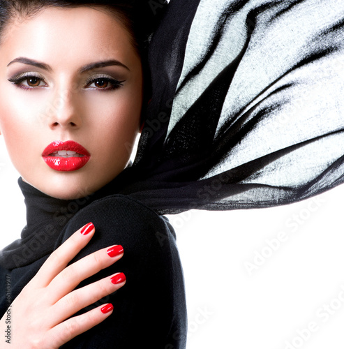Beautiful young woman with waving scarf.