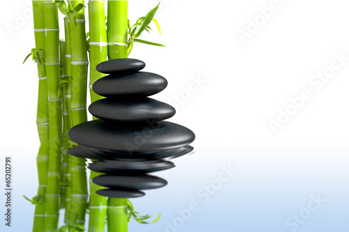 Photo  spa concept zen basalt stones with bamboo
