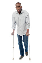African Man With Crutches Tryi...