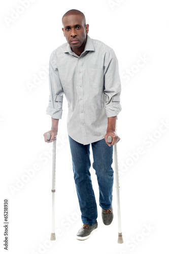 African man with crutches trying to walk Canvas Print