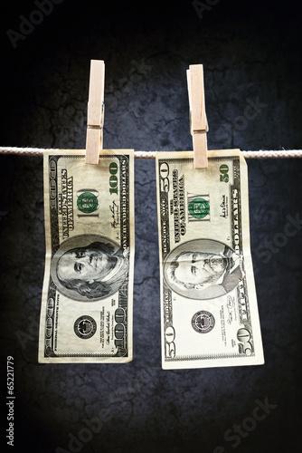 Valokuva  American Dollars hanging on rope