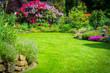 Leinwandbild Motiv Garten mit Rhododendren