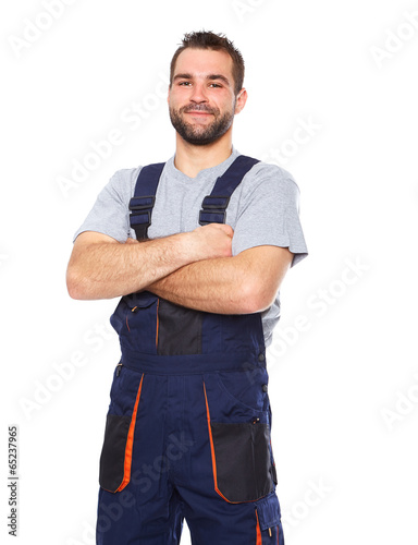 Fotografia  Portrait of smiling worker in blue uniform