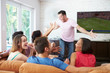 canvas print picture - Group Of Friends Sitting On Sofa Watching Soccer Together
