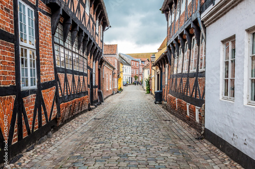 Keuken foto achterwand New York Street with old houses from royal town Ribe in Denmark