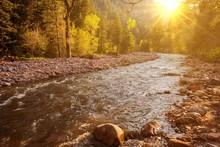 Mountain River At Sunset