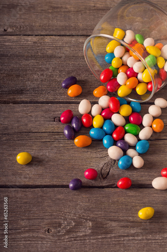 Garden Poster Candy sweets on wooden background