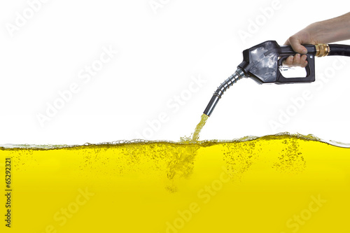 Photo  petrol pump nozzle hold by hand with gasoline