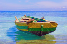 An Old Fishing Boat Docked Nea...
