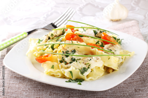 Fotografering  Pasta with seafood, tomatoes and chives
