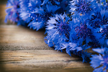 Cornflowers Over Wooden Backgr...