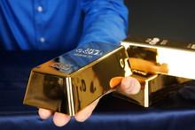 Businessman Holds At Hands Gold Brick