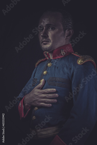old soldier style jacket with blue and gold epaulettes, Spanish