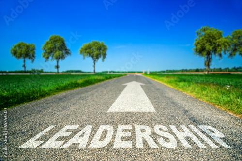 Leadership word painted on asphalt road