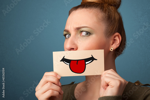Canvas Prints Textures Happy pretty woman holding card with funny smiley