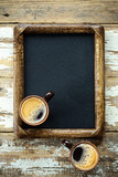 Coffee cups on vintage menu board