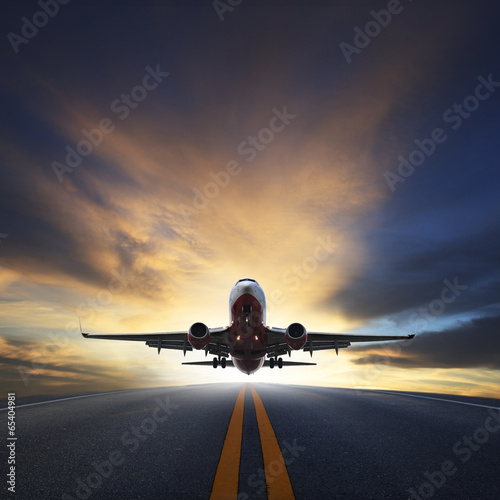 Fotografie, Obraz  passenger plane take off from runways against beautiful dusky sk