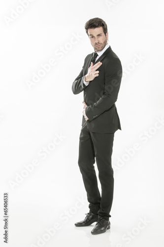 фотография  portrait of an expressive young man in suit on isolated backgrou