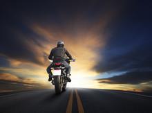 Young Man Riding Big Bike Motocycle On Asphalt High Way Against
