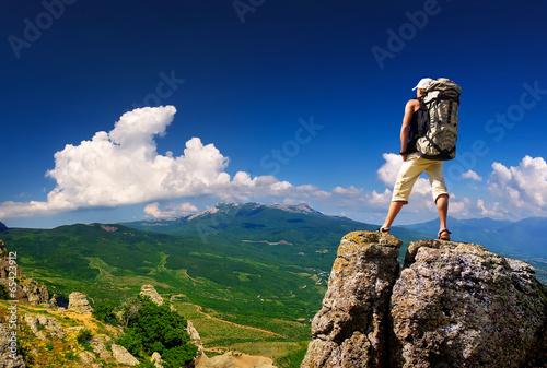 Fotografie, Obraz  Tourist on high rocks. Active life concept