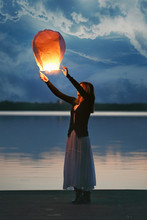 Chinese Sky Lantern And Young Woman At Dusk