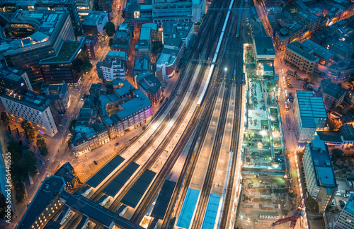 London. Train station and Tower Bridge night lights, aerial view