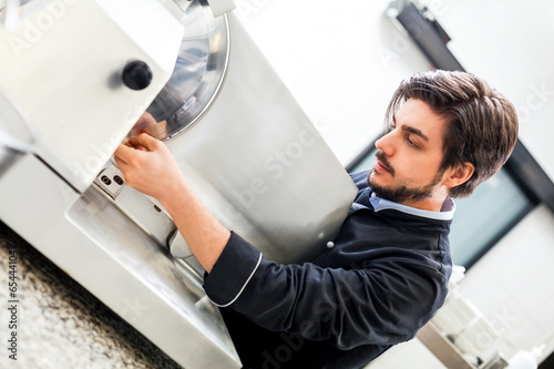 Fotografie, Obraz  Commercial cook or chef slicing cold meat