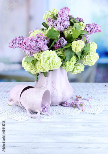 Composition With Tea Mugs And Beautiful Spring Flowers In Vase