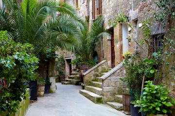 Fototapeta Uliczki Narrow Alley With Old Buildings In Italian City