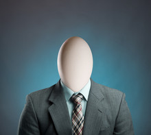 Businessman With Egg Istead Of...