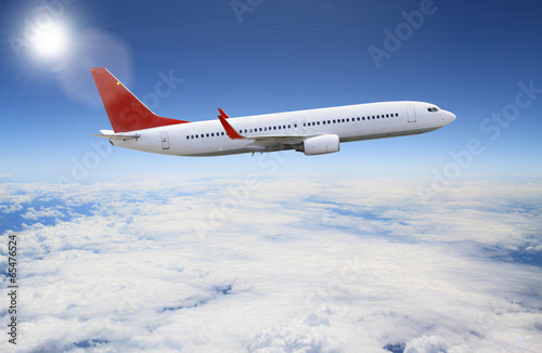 Fotografia  Plane flying over the clouds