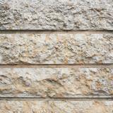 Old wall made of limestone blocks