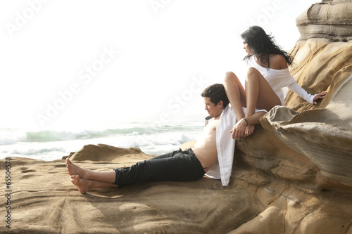 Poster Artist KB Young beautiful couple sharing a moment on beach wearing white