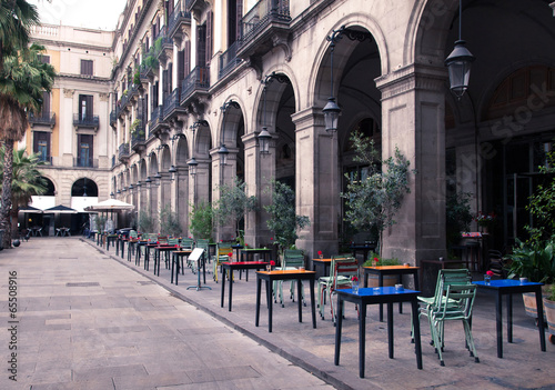 street cafe with colorful tables and chairs #65508916
