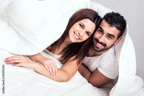 Photo  Couple in bed