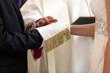 Newlyweds at the catholic church during wedding ceremony