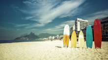 Surfboards Standing Upright In...