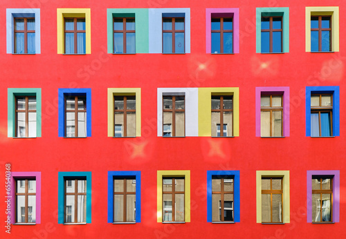 Fotografie, Obraz  Red facade with colourful windows