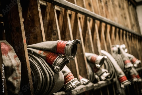 Storage room in firefighting depot with water hoses Fototapet