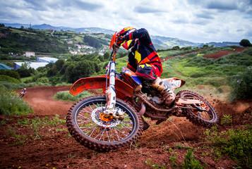 Fototapeta zawodnik na motocrossie
