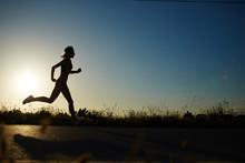 Silhouette Of Athletic Girl Ru...