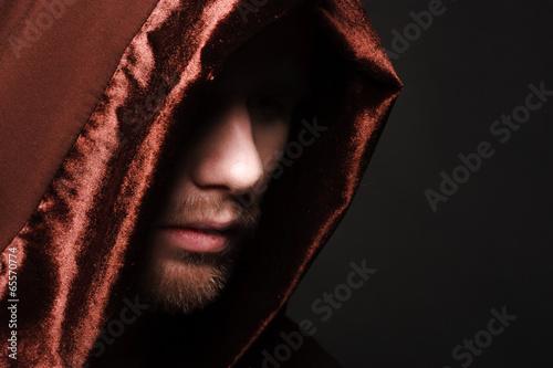 Portrait of mystery unrecognizable monk Poster
