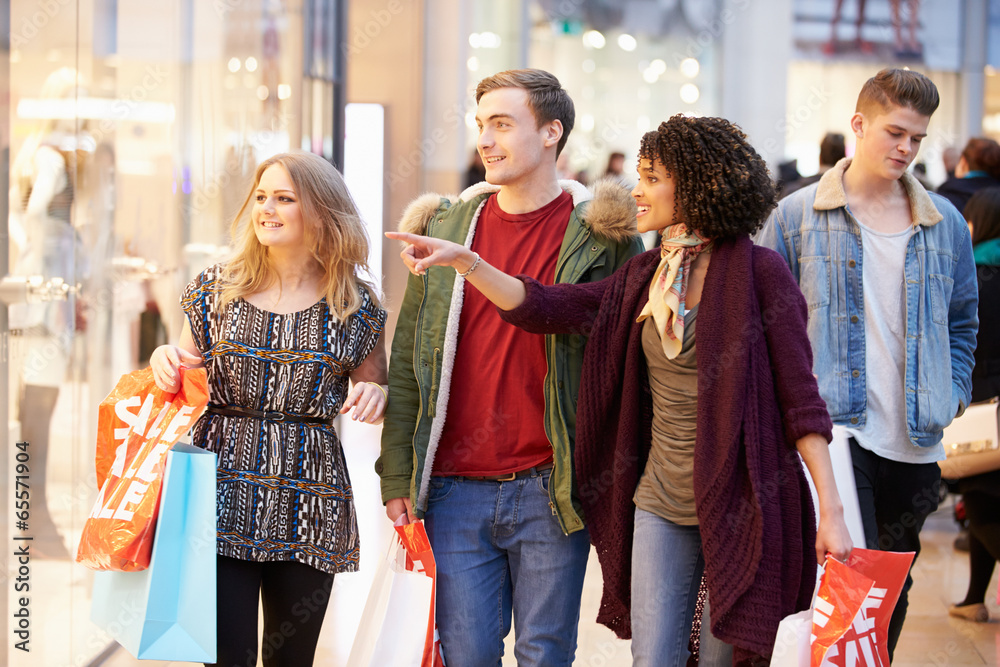 Fototapeta Group Of Young Friends Shopping In Mall Together