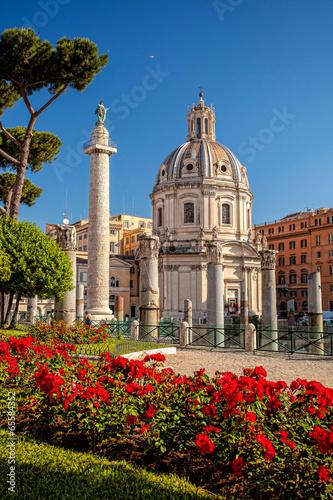 Photo  Trajan's Column with church in  Rome, Italy