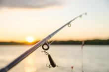 Fishing On A Lake Before Sunset