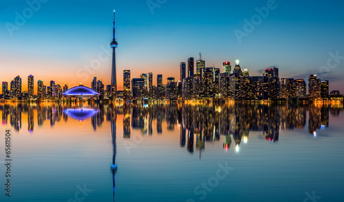 Toronto skyline at dusk reflected in the Inner Harbour Bay