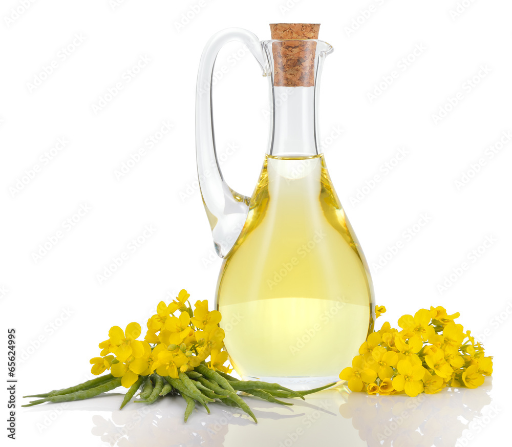Fototapeta Rapeseed oil and flowers isolated over white.