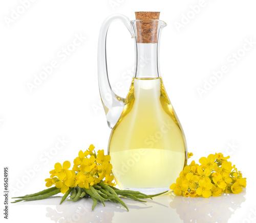 Fototapeta Rapeseed oil and flowers isolated over white. obraz