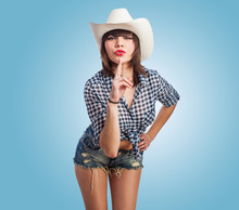 Portrait Of A Pretty Young Woman Wearing Like A Cowgirl